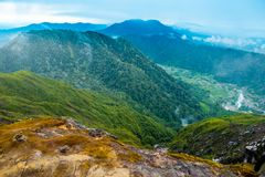 Dramatic landscape view of mountains and valley from sibayak volcano in sumatra indonesia stock photos