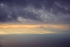 Dramatic landscape view of sunrise over mountains and the ocean. Amalfi coast, Italy stock photography