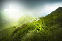 Dramatic landscape with white cross of light Stock Photography