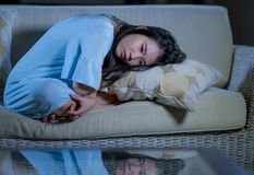 Young beautiful sad and depressed Asian Japanese woman at home sofa couch feeling overwhelmed suffering anxiety crisis and stock photos