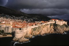 Dramatic light above Dubrovnik. Seaside view of the historic part of Dubrovnik, Croatia after a rain storm in mid-October royalty free stock image