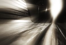 Free Dramatic Light Rays Falling On Park Bench Sepia Background Stock Images - 142990834