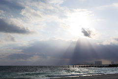 Dramatic light rays illuminating the city. On the shore of Caribbean sea Stock Images