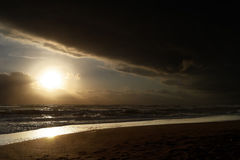 Dramatic lighted beach. Dramatic evening in Italy, black clouds Stock Photos