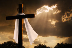 Dramatic Lighting on Christian Easter Cross As Sto. This dramatic lighting with storm clouds breaking and sunshine bursting through makes a great Easter photo Royalty Free Stock Photo