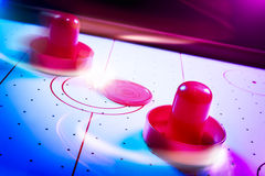 Dramatic lit air hockey table with light trails Royalty Free Stock Photo