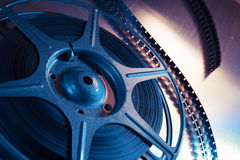 Dramatic lit image of a movie reel. Movie reel on a metalic background royalty free stock photography