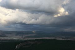 Dramatic low clouds over valley stock image