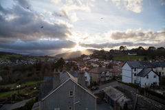 Conwy From The Town Walls. Dramatic low sun breaks through the clouds over a view of Conwy from the city town walls stock photo