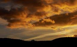 Dramatic magic sunset sky cumulus clouds at sunset. Dramatic magic beautiful evening sky cumulus clouds at sunset stock photos