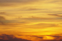 Dramatic and magistic orange cloudy sunset sky. Royalty Free Stock Image