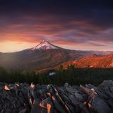 Dramatic and Majestic View of Mt. Hood on a bright, colorful sunset during the summer months. The Pacific Northwest, Oregon, USA. stock photos
