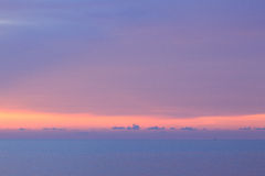 Dramatic minimalist pastel sunset sky and tropical sea Stock Photography