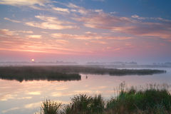 Dramatic misty sunrise over river Stock Image