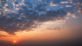 The Dramatic Moment of Sunset Sky and Clouds. Stock Photo