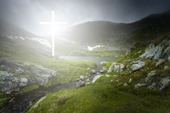 Dramatic moment of a white cross appearing over the lake Royalty Free Stock Photos