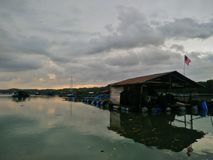 A dramatic morning sky over a kelong. Stock Photography