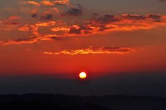 Dramatic Morning sky at Sunrise. Dramatic panorama morning sky at sunrise over mountains. The clouds are burning by the sun. Sunset. Fire Royalty Free Stock Images