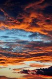Dramatic Morning sky at Sunrise. Dramatic panorama morning sky atnsunrise.The clouds are burning by the sun. Sunset. Fire Stock Images