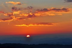 Dramatic Morning sky at Sunrise. Dramatic panorama morning sky at sunrise over mountains. The clouds are burning by the sun. Sunset. Fire Stock Photos