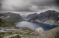 Dramatic mountain landscape in Scandinavia. Hiking travel in Norway during summer vacation in high mountain Stock Photo