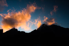 Dramatic mountains. Sun over the huge mountains Stock Photo