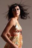 Dramatic movement by stunning studio fashion model Royalty Free Stock Image
