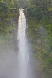 Dramatic, natural, tall waterfall in rain forest Stock Photo