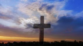 Christian cross on sunset background . cross beautiful. Dramatic nature background . Sunset or sunrise with clouds, light rays and other atmospheric effect stock image