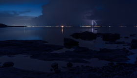 Dramatic nature background - thunders in dark sky over the sea Royalty Free Stock Image
