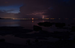 Dramatic nature background - thunders in dark sky over the sea Stock Image