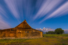 Dramatic night sky at Mormon Row with view at Grand Teton Stock Photography