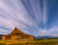 Dramatic night sky at Mormon Row with view at Grand Teton Stock Images