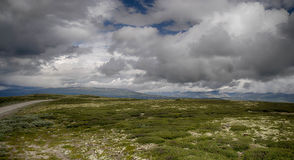 Dramatic norwegian landscape in cold summer Stock Images