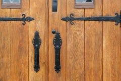 Dramatic oak wooden church doors Stock Images