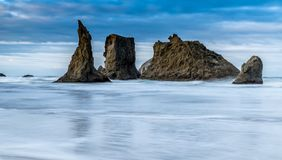 Dramatic ocean scene in Bandon Oregon. Dramatic sea stacks in Bandon Oregon ocean panorama no people banner wallpaper landscape Stock Image