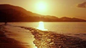 Dramatic orange sunrise over the beach. Slow motion. 1920x1080 stock video footage