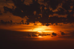 Dramatic orange sunset. With dark storm clouds Royalty Free Stock Photography