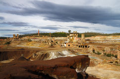 Dramatic overcast sky over ruined sulfur extraction ovens and chimneys Stock Photo