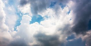 Dramatic panorama of blue sky and storm clouds background. Royalty Free Stock Image