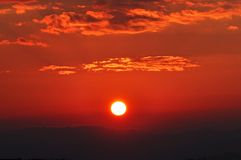 Dramatic Morning sky at Sunrise. Dramatic panorama morning sky at sunrise over mountains. The clouds are burning by the sun. Sunset. Fire Royalty Free Stock Photo