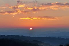 Dramatic Morning sky at Sunrise. Dramatic panorama morning sky at sunrise over mountains. The clouds are burning by the sun. Sunset. Fire Stock Photography