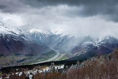 Panoramic view on snow winter mountains and cloud sky. Caucasus Mountains. Svaneti region of Georgia. Dramatic Panoramic view on snow winter mountains and Royalty Free Stock Images