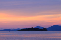 Dramatic pastel sunset sky and tropical sea image with island Stock Photography