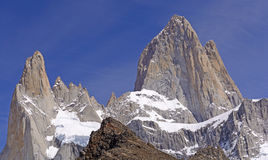 Dramatic Peaks Piercing a Blue Sky Stock Photography