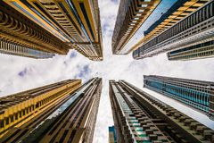 Free Dramatic Perspective With Low Angle View Of Skyscrapers Looking Up To The Sky, Dubai Stock Image - 134572451