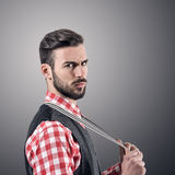 Dramatic portrait of angry bearded hipster with intense look at camera Royalty Free Stock Photography