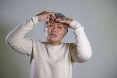 Dramatic portrait of attractive sad and depressed middle aged Asian woman crying helpless suffering depression problem and anxiety royalty free stock image