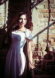 Dramatic portrait of beautiful young woman in white dress Stock Photography