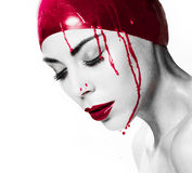 Dramatic portrait of a bleeding woman Royalty Free Stock Photography